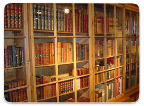 A book case containing a large selection of old books