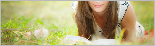 girl reading on the grass graphic