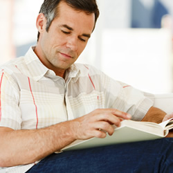 man reading book on chair graphic