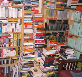 A room cluttered with books of all genres