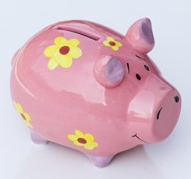 Pink traditional piggy bank decorated with yellow flowers