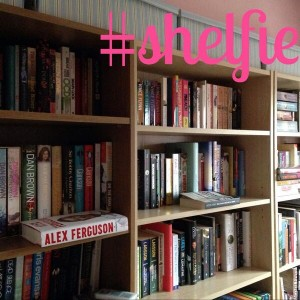 A customer's shelfie stacked with books