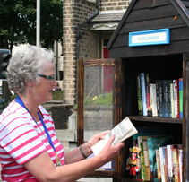 A local community member making the most of the We Buy Books Free Little Library